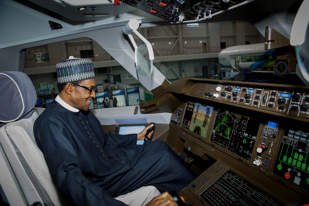 President Buhari in the cockpit of a plane